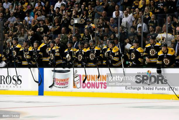 The Boston bench applauds a fight during an NHL game between the Boston Bruins and the Nashville Predators on October 5 at TD Garden in Boston...