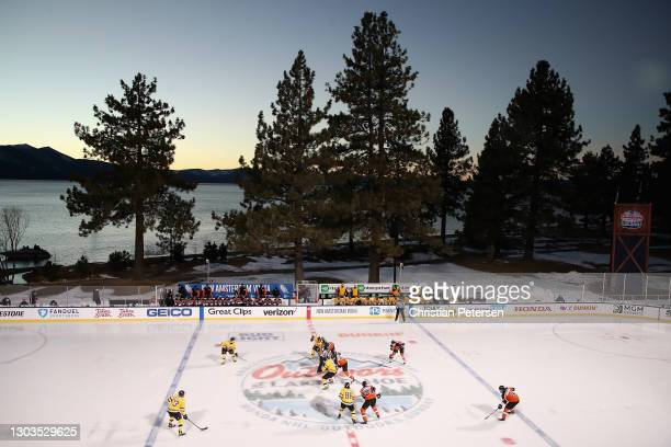 The Boston Bruins and Philadelphia Flyers face off to start the second period during the 'NHL Outdoors At Lake Tahoe' at the Edgewood Tahoe Resort...