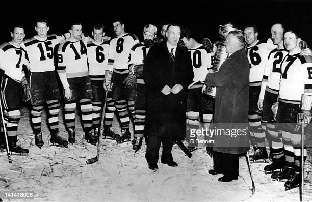 The Boston Bruins are presented the Stanley Cup Trophy after defeating the Toronto Maple Leafs in Game 5 of the 1939 Stanley Cup Finals on April 16,...
