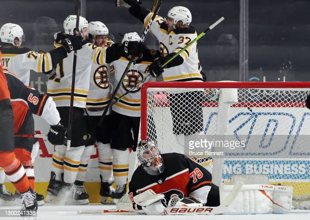 The Boston Bruins celebrate a game tying goal by David Pastrnak against Carter Hart of the Philadelphia Flyers at 19:45 o the third period at Wells...