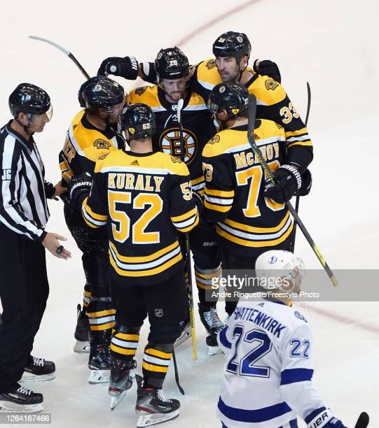 The Boston Bruins celebrate a goal by Chris Wagner against the Tampa Bay Lightning at 147 of the third period in an Eastern Conference Round Robin...