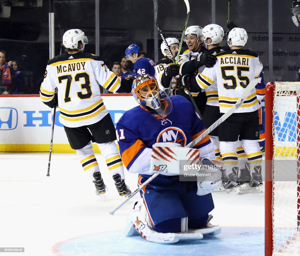 The Boston Bruins celebrate a goal by Tim Schaller #59 (4th from left) against Jaroslav Halak #41 of the New York Islanders at 15:02 of the third period at the Barclays Center on January 2, 2018 in the Brooklyn borough of New York City.