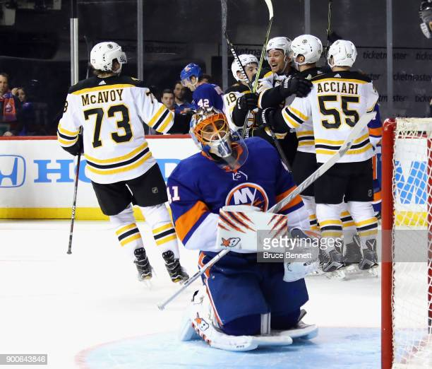 The Boston Bruins celebrate a goal by Tim Schaller against Jaroslav Halak of the New York Islanders at 1502 of the third period at the Barclays...
