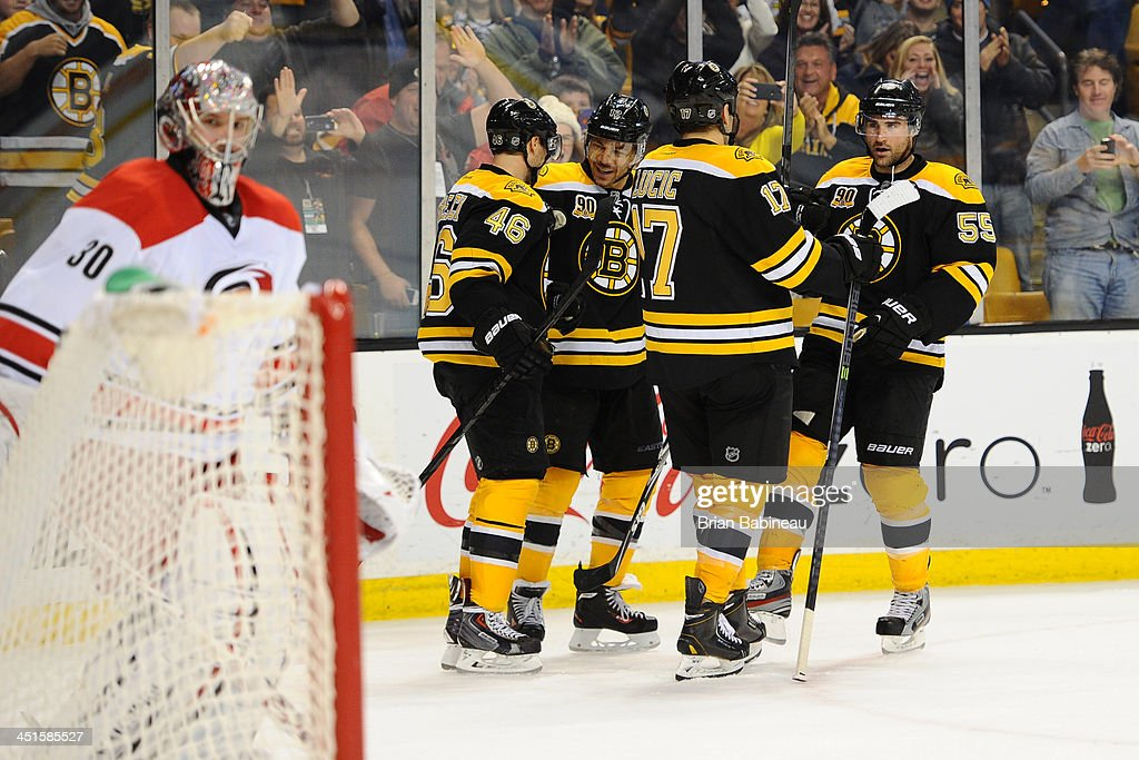 The Boston Bruins celebrate a goal in overtime against the Carolina Hurricanes at the TD Garden on November 23, 2013 in Boston, Massachusetts.