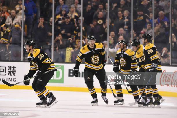 The Boston Bruins celebrate a goal in the second period against the Tampa Bay Lightning at the TD Garden on November 29 2017 in Boston Massachusetts