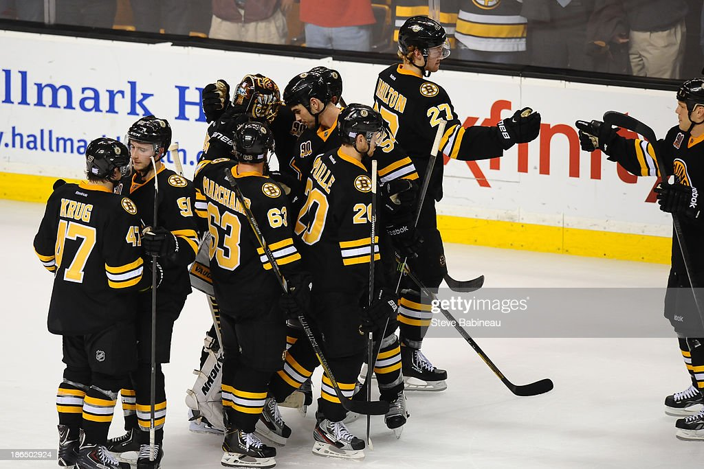 The Boston Bruins celebrate a shoot-out win against the Anaheim Ducks at the TD Garden on October 31, 2013 in Boston, Massachusetts.