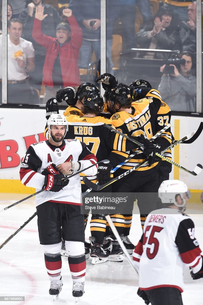 The Boston Bruins celebrate a third period goal against the Arizona Coyotes at the TD Garden on December 7, 2017 in Boston, Massachusetts.