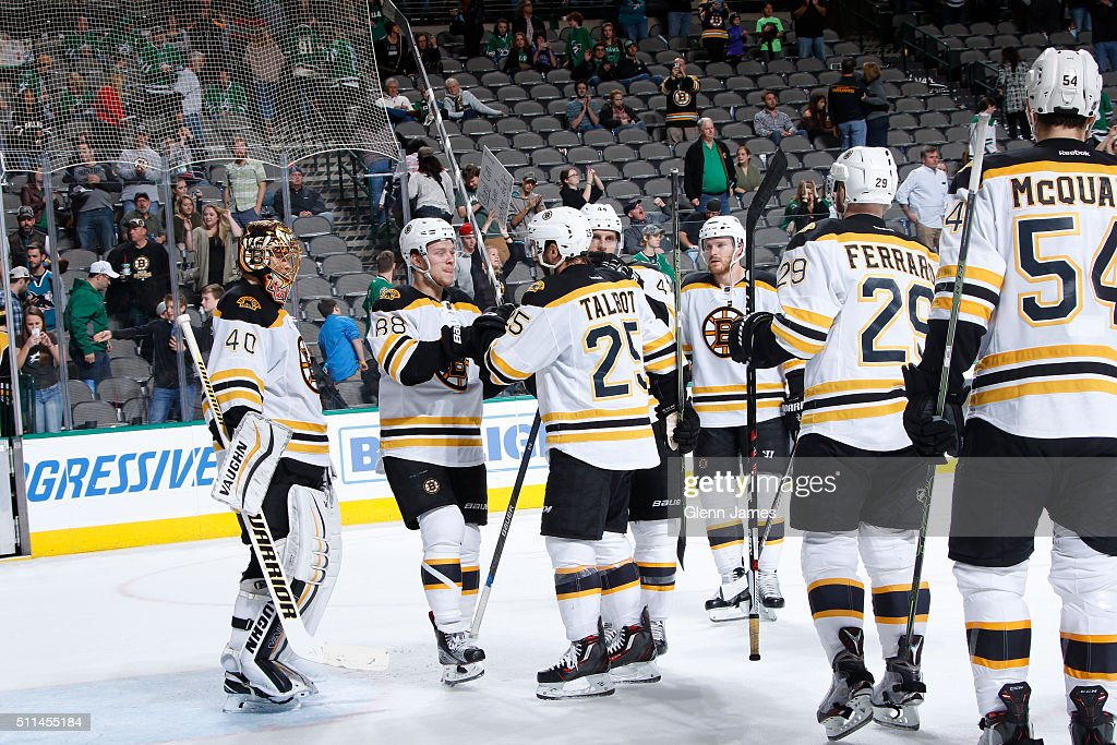 The Boston Bruins celebrate a win against the Dallas Stars at the American Airlines Center on February 20, 2016 in Dallas, Texas.