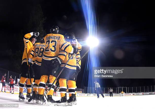 The Boston Bruins celebrate after David Pastrnak scored a goal against the Philadelphia Flyers making it 7-3 in the third period of the 2021 NHL...