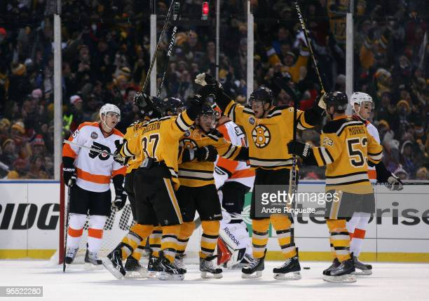 The Boston Bruins celebrate after Mark Recchi scored a third period goal to tie the game 11 the against the Philadelphia Flyers during the 2010...