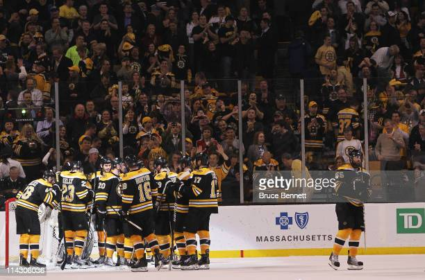 The Boston Bruins celebrate their 6 to 5 win over the Tampa Bay Lightning in Game Two of the Eastern Conference Finals during the 2011 NHL Stanley...