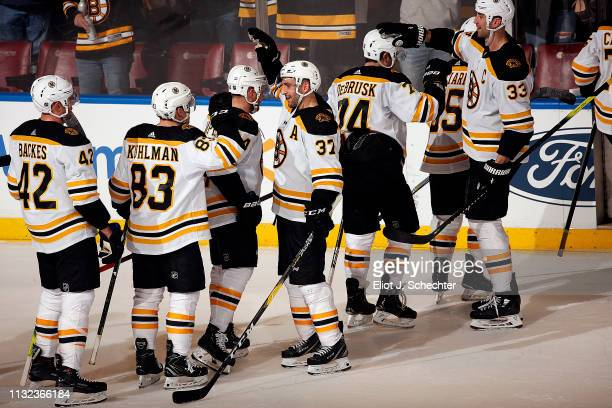 The Boston Bruins celebrate their 73 win over the Florida Panthers at the BBT Center on March 23 2019 in Sunrise Florida