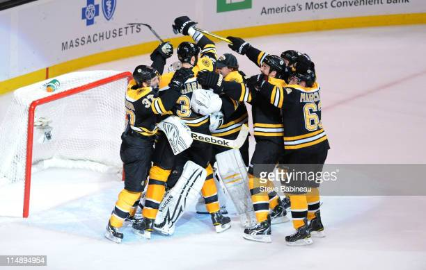 The Boston Bruins celebrate winning against the Tampa Bay Lightning in Game Seven of the Eastern Conference Finals during the 2011 NHL Stanley Cup...