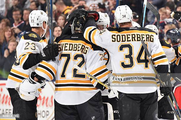 The Boston Bruins celebrate with goaltender Niklas Svedberg of the Boston Bruins after defeating the Columbus Blue Jackets 43 in a seven round...