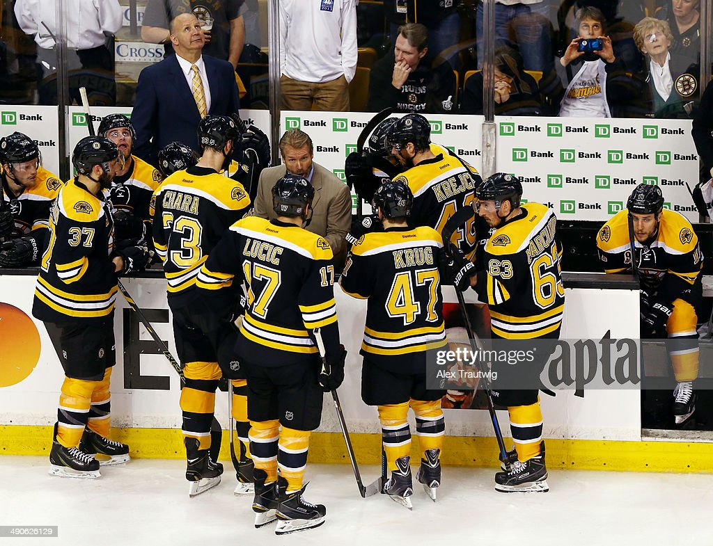 The Boston Bruins huddle in the closing minutes of Game Seven of the Second Round of the 2014 NHL Stanley Cup Playoffs against the Montreal Canadiens at the TD Garden on May 14, 2014 in Boston, Massachusetts.