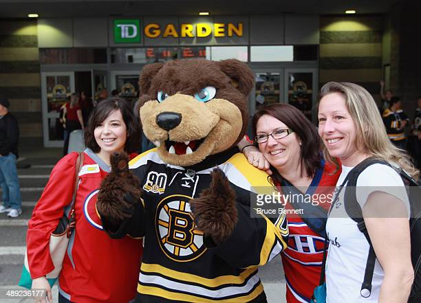 The Boston Bruins mascot Blades poses with Montreal Canadiens fans prior to Game Five of the Second Round of the 2014 NHL Stanley Cup Playoffs at the...