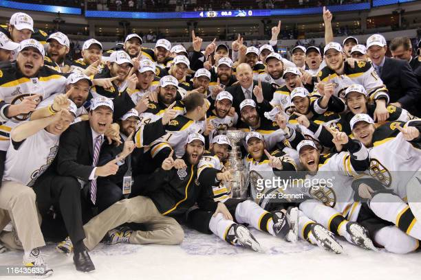 The Boston Bruins pose with the Stanley Cup after defeating the Vancouver Canucks in Game Seven of the 2011 NHL Stanley Cup Final at Rogers Arena on...