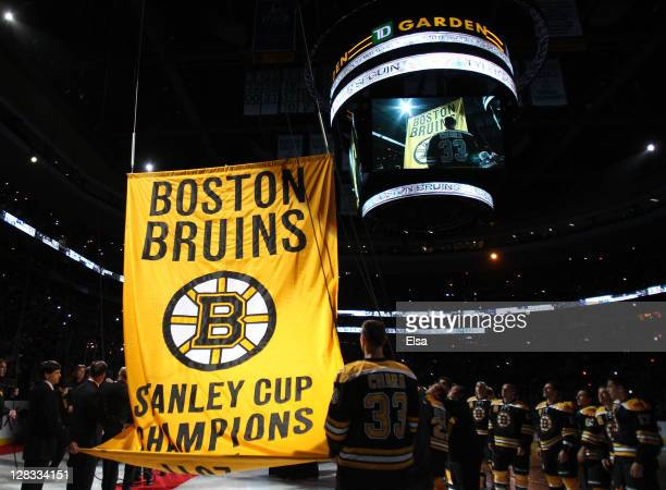 The Boston Bruins raise their 201111 Stanley Cup Championship Banner before the start of the home opener against the Philadelphia Flyers on October 6...
