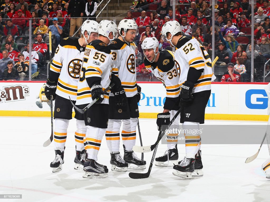 The Boston Bruins talk against the New Jersey Devils during the game at Prudential Center on November 22, 2017 in Newark, New Jersey.