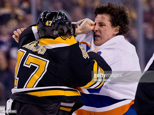 The Boston Bruins' Torey Krug fights with the New York Islanders' Ryan Strome during first period action at TD Garden on February 7 2015
