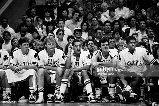 The Boston Celtics' 198586 championship starters Danny Ainge Larry Bird Dennis Johnson Kevin McHale and Robert Parish sit on the bench during a game...