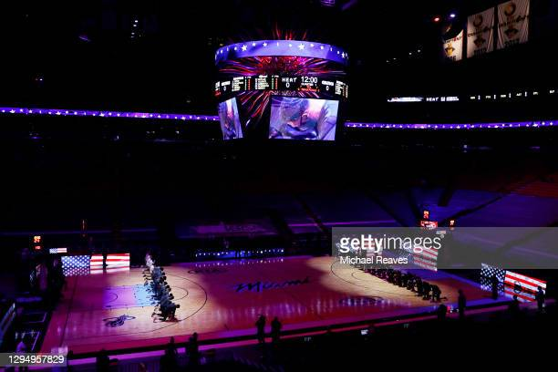 The Boston Celtics and the Miami Heat kneel during the playing of the national anthem prior to the game at American Airlines Arena on January 06,...