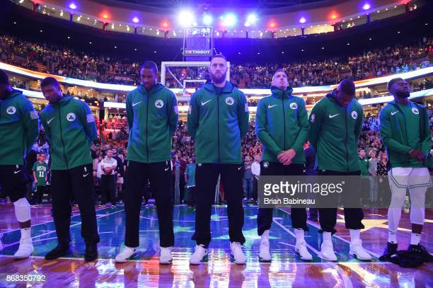 The Boston Celtics are seen during the National Anthem before the game against the San Antonio Spurs on October 30 2017 at the TD Garden in Boston...