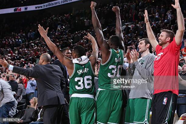The Boston Celtics bench celebrates a victory against the Portland Trail Blazers on January 22 2015 at the Moda Center in Portland Oregon NOTE TO...