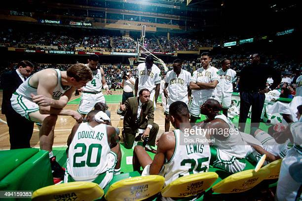 The Boston Celtics huddle around Head Coach Chris Ford during a timeout during a game played at the Boston Garden in Boston Massachusetts circa 1993...