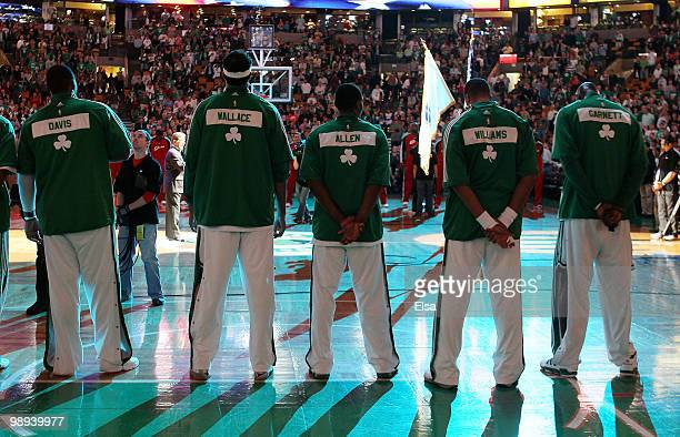 The Boston Celtics line up as the national anthem is played before Game Four of the Eastern Conference Semifinals of the 2010 NBA playoffs at TD...
