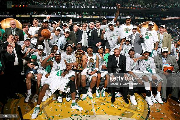 The Boston Celtics organization celebrate with the Larry O'Brien championship trophy after defeating the Los Angeles Lakers in Game Six of the 2008...