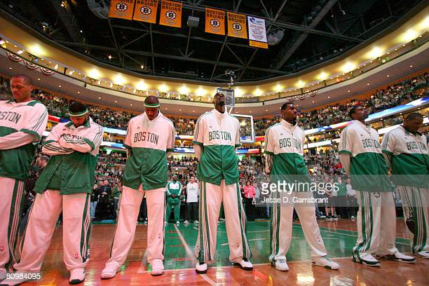 The Boston Celtics stand during the national anthem prior to playing against of the Atlanta Hawks in Game Seven of the Eastern Conference...