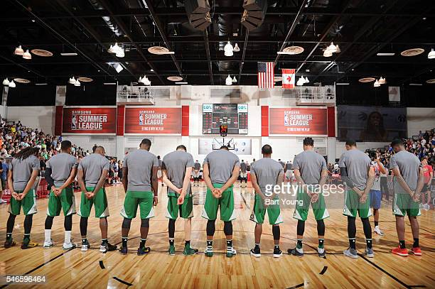 The Boston Celtics stand for the national anthem before the game against the Dallas Mavericks during the 2016 NBA Las Vegas Summer League game on...