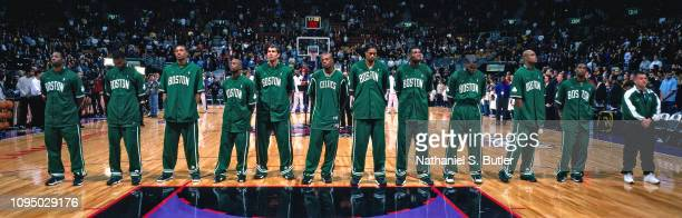 The Boston Celtics stand for the National Anthem prior to a game against the Toronto Raptors on November 2 1999 at the Air Canada Centre in Toronto...