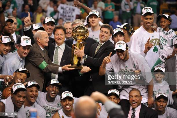 The Boston Celtics' team pose with the NBA trophy after winning Game 6 of the 2008 NBA Finals in Boston, Massachusetts, June 17, 2008. The Boston...