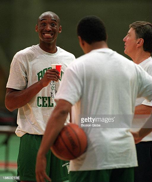 The Boston Celtics try out Kobe Bryant as coaches look on Kobe puts on a grin for the photographer
