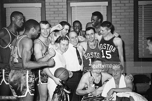 The Boston Celtics whoop it up' in the dressing room after they beat the Minneapolis Lakers 118113 to win the NBA title here 4/9 The Celtics won four...