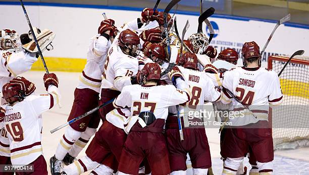 The Boston College Eagles celebrate a 32 victory against the Minnesota Duluth Bulldogs after the NCAA Division I Men's Ice Hockey Northeast Regional...
