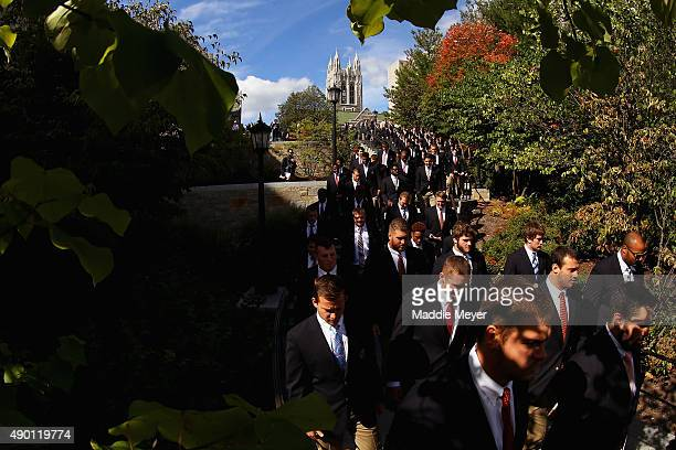 The Boston College Eagles participate in the Eagle Walk a procession across campus to Alumni Stadium before their game against the Northern Illinois...