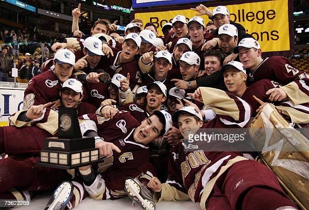 The Boston College Eagles pose with the championship trophy after they defeated the New Hampshire Wildcats to win the Hockey East Tournament on March...