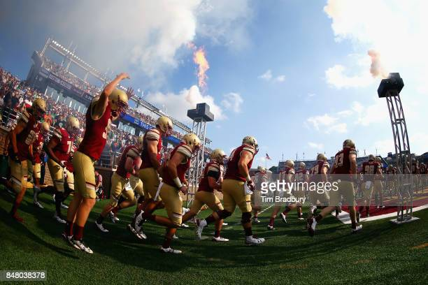 The Boston College Eagles run onto the field prior to the game against the Notre Dame Fighting Irish at Alumni Stadium on September 16, 2017 in...