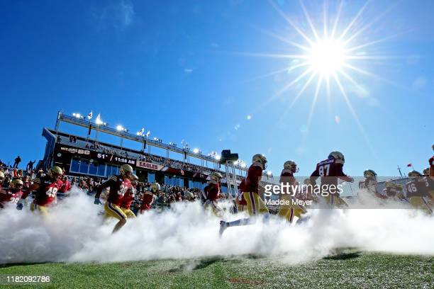 The Boston College Eagles take the field before their game against the North Carolina State Wolfpack at Alumni Stadium on October 19, 2019 in...