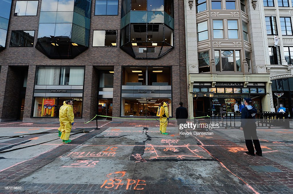 The Boston Fire Department Hazardous Materials team clean the blast site near the Boston Marathon finish line one week after the FBI handed over Boylston street back to the city on April 22, 2013 in Boston, Massachusetts. A manhunt ended for Dzhokhar A. Tsarnaev, 19, a suspect in the Boston Marathon bombing after he was apprehended on a boat parked on a residential property in Watertown, Massachusetts. His brother Tamerlan Tsarnaev, 26, the other suspect, was shot and killed after a car chase and shootout with police. The bombing, on April 15 at the finish line of the marathon, killed three people and wounded at least 170.