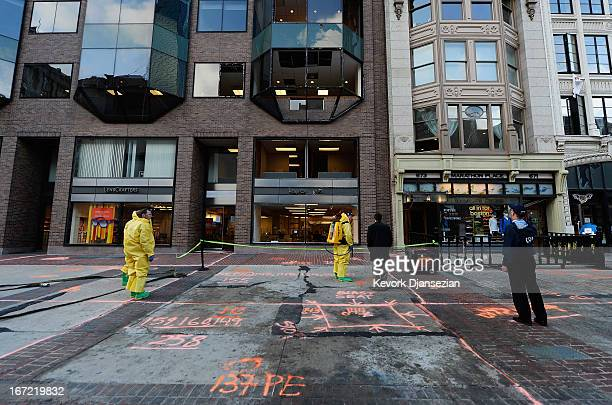 The Boston Fire Department Hazardous Materials team clean the blast site near the Boston Marathon finish line one week after the FBI handed over...