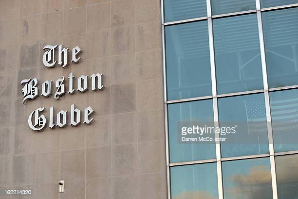 The Boston Globe signage hangs on the side of its building on February 20 2013 in Boston Massachusetts The New York Times Company which owns The...