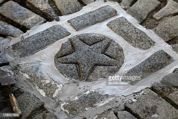 The Boston Massacre site in front of the Old State House was undergoing cobblestone repairs