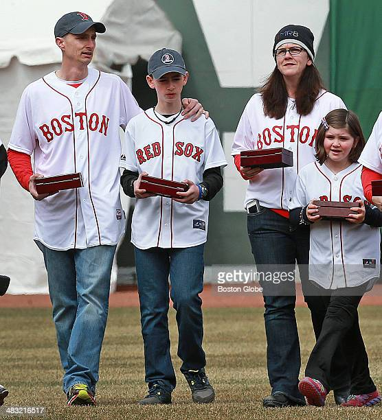The Boston Red Sox 2013 World Series team received their championship rings during a pregame ceremony before their home opener at Fenway Park against...