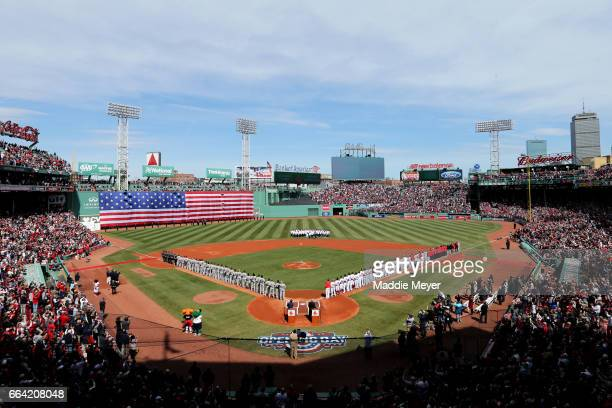 The Boston Red Sox and the Pittsburgh Pirates lineup for the national anthem before the opening day game at Fenway Park on April 3, 2017 in Boston,...