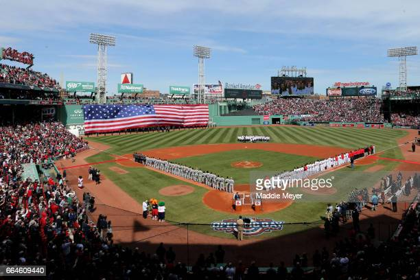 The Boston Red Sox and the Pittsburgh Pirates lineup for the national anthem before the opening day game at Fenway Park on April 3 2017 in Boston...