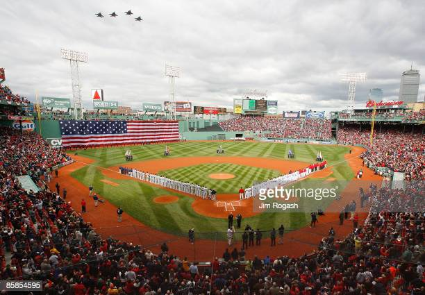 The Boston Red Sox and the Tampa Bay Rays line the field before their opening day game at Fenway Park April 7, 2009 in Boston, Massachusetts.